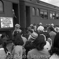 Crowd gathered at a train departing for California