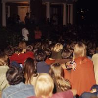 Students gather at night