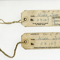 Luggage tags used by Tom Hide.